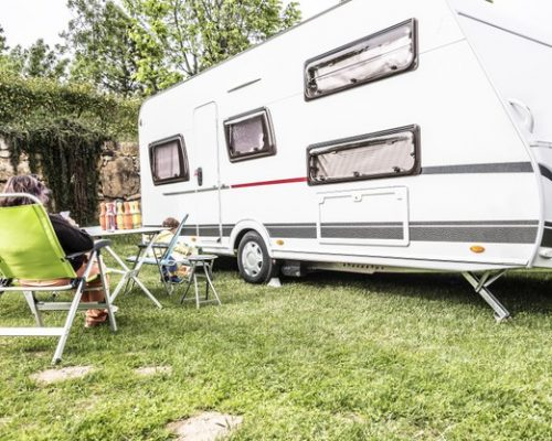 caravan-middle-nature-with-tables-chairs_337384-398
